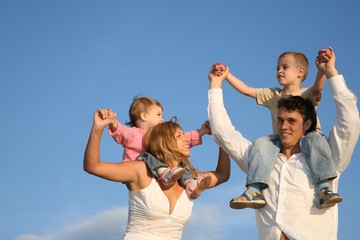 Smiling family on sky background