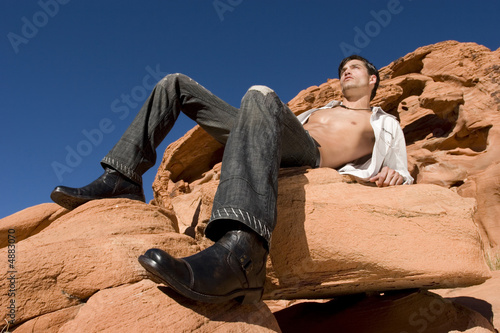 Sexy man on red rocks