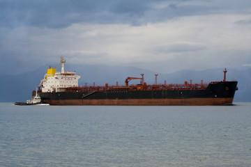 cargo ship and tug-boat