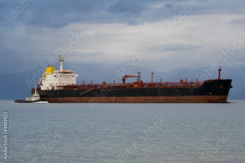 cargo ship and tug-boat
