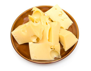 cheese on a brown plate