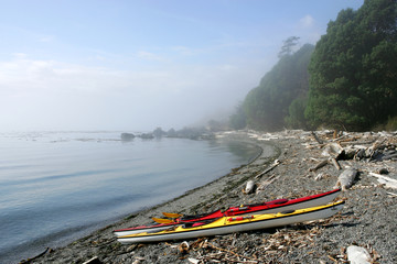 Sea kayaks on remote beach