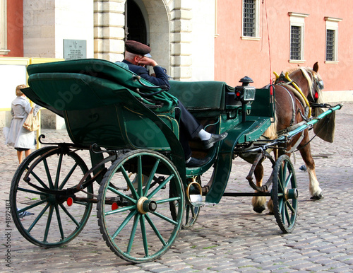 Carriage with a sleeping coachman in Warsaw Old Town