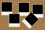 Blank polaroid photos on a board poster
