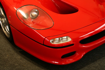 the front headlight on a red supercar