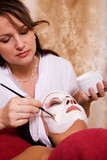 young woman in beauty salon, beauty mask poster