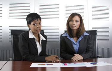 Two female business graph