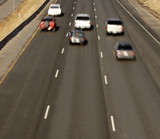 Blurred Fast Cars on the Highway poster