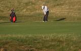 golf player hitting chip shot poster