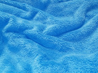 detail of the blue crumpled blanket
