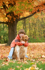 Boy Hugging Golden Retriever