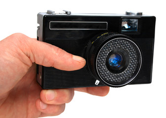 aged camera in an hand