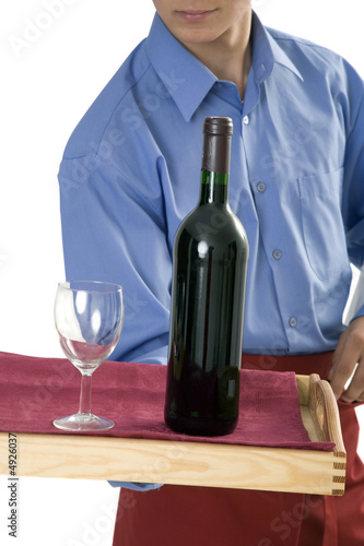 Waiter carrying wine