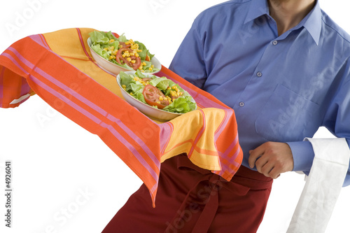 Waiter serves salads