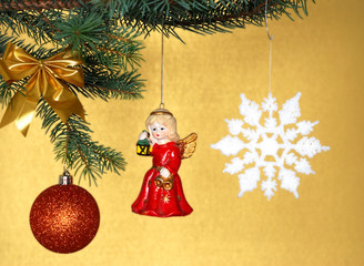 Christmas decorations opposite golden background