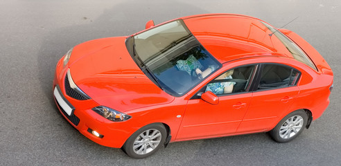 """red car isolated on gray asphalt of my """"generic cars"""" sries"""