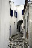Archway over narrow street at Leukes. Paros, Greece-