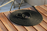 Coiled line of boat rope on dock poster