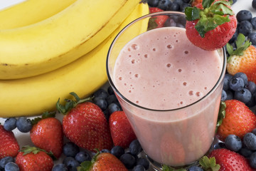 Smoothie surrounded by fruit