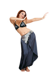 Pretty smiling bellydancer in costume dancing gracefully