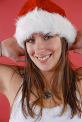 Young woman in a Santa hat