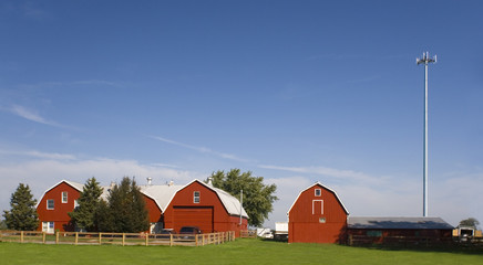 Red farm with a cell tower.