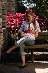 Pretty teenage Girl Sitting on Bench