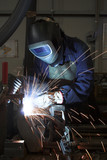 Welding welding a metal part in an industrial environment poster