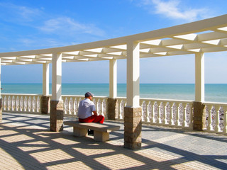 The man relaxing in summerhouse near Mediterranian sea