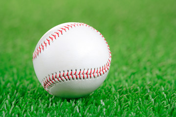 Baseball ball on a green grass background