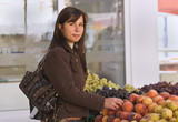 Woman buying fruits poster