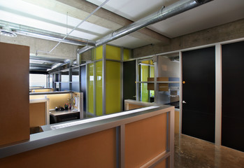 Modern office interior with cubicles and private rooms