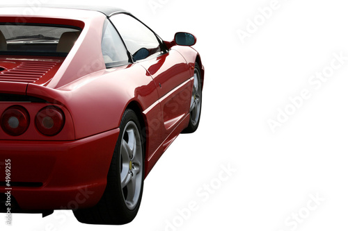 side of red supercar cut out on white background