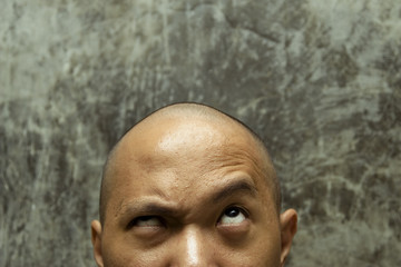 bald headed man with confuse expression