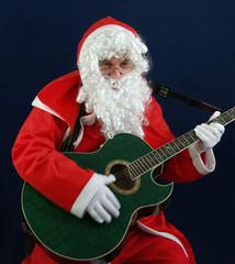 Santa singing carols at christmas on the guitar