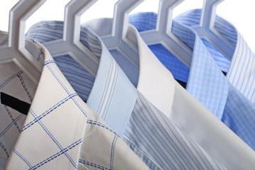 Five white-and-blue shirts