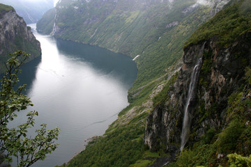 view of Geiranger fjord Norway with waterfall