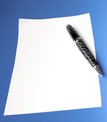 pen and sheet of white paper