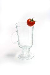 Cherry tomatos  on glass (cup)