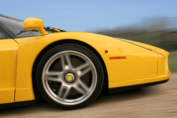 Bright yellow Italian super car