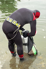 scuba diver in wet suit