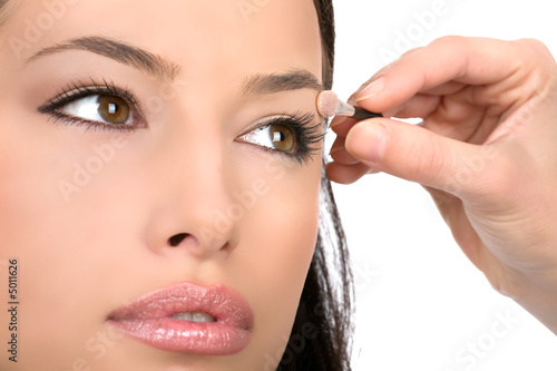 applying cosmetic with applicator