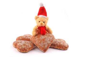 teddy bear on pile of honey-cakes