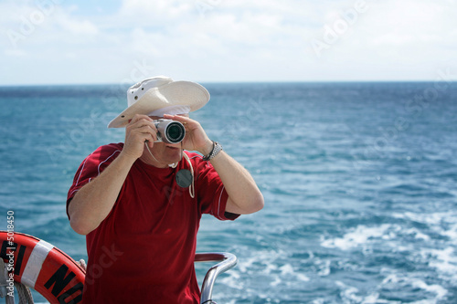 A man taking photos from a boat