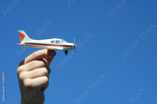 boy holding toy airplane