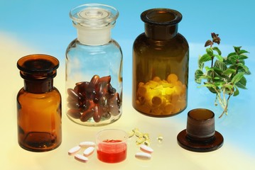 Glass full of  pharmaceuticals on color background