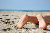 close up of bare feet on beach poster