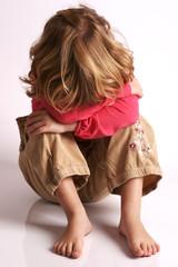 Little girl alone, afraid, hiding, feeling sad