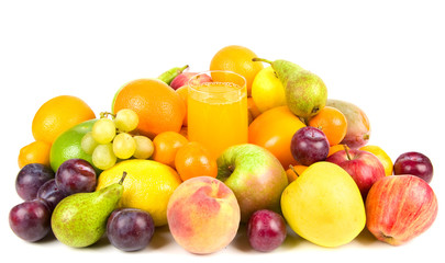Pile of fruits around the glass of fruit juice isolated on white