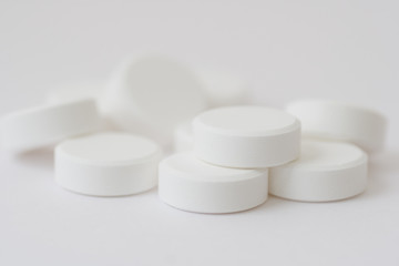 White pills, isolated, over white background